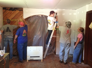 Our team hard at work on dry wall.